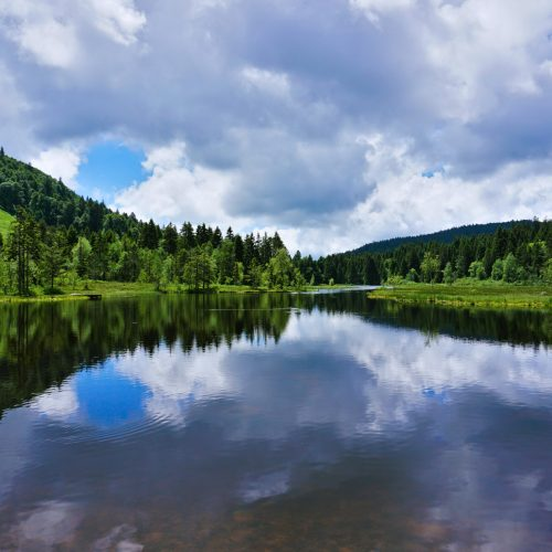 beautiful-view-of-the-lispach-lake-in-alsace-france-the-clouds-are-perfectly-reflected-on-the-clear-calm-water